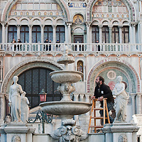 VENICE, ITALY - FEBRUARY 19:  Final touches at the wine fountain in St Mark Square ahead of the opening ceremony of the Carnival 2011 on February 19, 2011 in Venice, Italy. The fountain pouring wine features today during the Gran brindisi a Venezia or Grand Toast in Venice, the opening ceremony of this year Carnival .