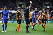 Hull City defender Scott Kingsley (28) is shown a yellow card, booked  during the EFL Sky Bet Championship match between Hull City and Cardiff City at the KCOM Stadium, Kingston upon Hull, England on 28 April 2018. Picture by Mick Atkins.