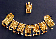 Seven gold plaques showing Artemis as 'Mistress of Animals' Greek, Orientalizing period, about 660-620 BC From Rhodes, Aegean Sea. These seven gold plaques were designed to be strung together and worn along the top edge of a garment, with the rosettes pinned to it at the shoulders. The plaques are of sheet gold, and are identical in form, though the added decoration in filigree and granulation on the dress of the goddess and the bodies of the lions is different in each case, creating a rich effect. Pomegranates, which were symbols of fertility, hang from the bottom of each plaque.
