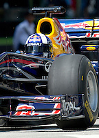Former Red Bull Formula One driver David Coulthard of Britain steers his car during a street demonstration in downtown Kuala Lumpur, Malaysia, Sunday, April 3, 2011. (Photo/Juan Manuel Serrano)