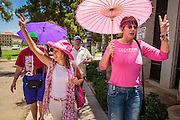 "31 JULY 2012 - PHOENIX, AZ:  MEDEA BENJAMIN, left, and other members of Code Pink march around the Arizona State Capitol Tuesday. Medea is a political activist, best known for co-founding Code Pink and, along with her husband, activist and author Kevin Danaher, the fair trade advocacy group Global Exchange. She was also a Green Party candidate in 2000 for the United States Senate. She appeared in Phoenix to promote her new book, ""Drone Warfare: Killing by Remote Control."" She, and other members of Code Pink, presented a letter to Arizona Gov. Jan Brewer protesting Brewer's request to use the state's airspace to train drone pilots.  PHOTO BY JACK KURTZ"