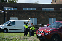 June 25, 2017 - Police gather evidence at the scene of a fatal car crash at the Westgate Sports Centre on West Road, Newcastle. A car hit worshippers leaveing Eid prayers at there are believed to be at least six people hurt in the incidentc. A 42 year old woman was arrested at the scene. (Credit Image: © Mary Turner/London News Pictures via ZUMA Wire)
