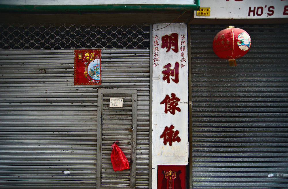 Shops displaying Chinese new year deocrations, closed for the holiday, on Hollywood Road, Hong Kong