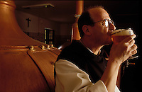 Brother Lode, a Trappist Monk, enjoys a beer at the Orval Brewery in Belgium.