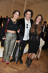Left to right, ALIX DUVERNOY, ADAM WAYMOUTH and RUBY BOGLIONE at a Private View of 'Calder - After The War' at Pace London, Burlington Gardens, London on 18th April 2013.
