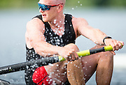 Will Crothers, 2012 Olympic silver medalist and now member of the Canadian mens rowing four that will represent Canada at the Rio Olympic games checks his course during a morning training session on Elk Lake in Victoria, British Columbia on June 22, 2016.