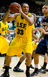 January 30, 2010; San Francisco, CA, USA;  San Francisco Dons forward Dior Lowhorn (33) is guarded by Gonzaga Bulldogs forward Elias Harris (20) during the second half at the War Memorial Gym.  San Francisco defeated Gonzaga 81-77 in overtime.