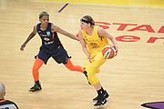 Los Angeles Sparks guard Sydney Wiese (24) dribbles as Connecticut Sun guard Courtney Williams (10) defends during a WNBA basketball game, Friday, May 31, 2019, in Los Angeles.The Sparks defeated the Sun 77-70.  (Dylan Stewart/Image of Sport)