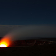 The Halema'uma'u Crater glows red after dark in Hawaii Volcanoes National Park.