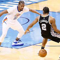 06 May 2016: Oklahoma City Thunder forward Kevin Durant (35) defends on San Antonio Spurs forward Kawhi Leonard (2) during the San Antonio Spurs 100-96 victory over the Oklahoma City Thunder, during Game Three of the Western Conference Semifinals of the NBA Playoffs at the Chesapeake Energy Arena, Oklahoma City, Oklahoma, USA.