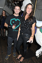TYRONE WOOD and INDIA LANGTON at a carnival themed party hosted by Stacey Bendet for the Alice & Olivia fashion label at Paradise, Kensal Green, London on 9th November 2011