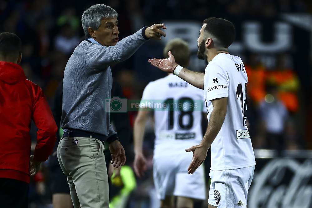 February 28, 2019 - Valencia, Spain - Head coach   of Real Betis Balompie Quique Setien (L) and Jose Luis Gaya of Valencia CF During Spanish King La Copa match between  Valencia cf vs Real Betis Balompie Second leg  at Mestalla Stadium on February 28, 2019. (Photo by Jose Miguel Fernandez/NurPhoto) (Credit Image: © Jose Miguel Fernandez/NurPhoto via ZUMA Press)