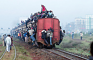 NAIROBI, KENYA.  Kenyans pack a Nairobi bound railroad train on Tuesday, February 3, 2004. Thousands of Kenyans are effected by a limited numbered of matatus, buses and mini-buses on Kenya's roadways, as strict vehicle transportation safety laws went into effect yesterday.  © Chet Gordon • Photographer