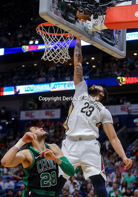 Mar 18, 2018; New Orleans, LA, USA; New Orleans Pelicans forward Anthony Davis (23) tips in a ball past Boston Celtics forward Abdel Nader (28) during the first quarter at the Smoothie King Center. Mandatory Credit: Derick E. Hingle-USA TODAY Sports