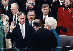 Chief Justice William Rehnquist administers the oath of office to US President George H.W. Bush on the west front of the U.S. Capitol, as Vice President Dan Quayle and Barbara Bush looking on, in Washington, D.C., USA on January 20, 1989. Photo by Architect of the Capitol/Library of Congress/MCT/ABACAPRESS.COM