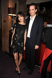 FRITZ VON WESTENHOLZ and CAROLINE SIEBER at a party to celebrate the launch of Hollywood Domino - a brand new board game, held at Mosimann's 11b West Halkin Street, London on 7th November 2008.  The evening was in aid of Charlize Theron's Africa Outreach Project.