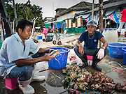 01 OCTOBER 2015 - MAHACHAI, SAMUT SAKHON, THAILAND:  Workers sort fresh crabs in the market in Mahachai, one of Thailand's largest fishing ports. Thailand's fishing industry had been facing an October deadline from the European Union to address issues related to overfishing and labor practices. Failure to adequately address the issues could have resulted in a ban on Thai exports to the EU. In September Thai officials announced that they had secured an extension of the deadline. Officials did not say how much extra time they had to meet the EU goals. Thailand's overall annual exports to the EU are between 23.2 billion Thai Baht and 30 billion Thai Baht (US$645 million to US $841 million). Thailand's total fish exports were worth about 110 billion baht in 2014.   PHOTO BY JACK KURTZ