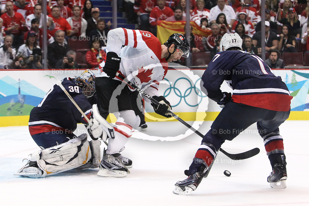 28 February 2010: Canada's Joe Thornton #19 and USA's Ryan Kesler #17 battle for the puck in front of USA's goalie Ryan Miller #39 during the Gold medal Hockey Final between the United States and Canada during the Vancouver 2010 Winter Olympics  in Vancouver,  British Columbia, Canada..