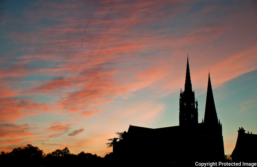 Silhouette of Chartres Cathedral, France, at sunrise.