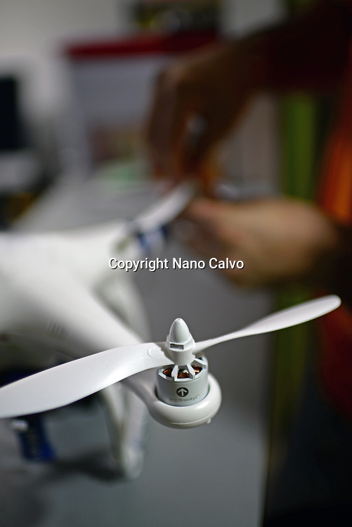 Young man mounting propeller blades on Phantom Drone