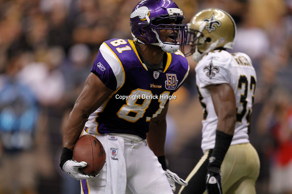 September 9, 2010; New Orleans, LA, USA; Minnesota Vikings tight end Visanthe Shiancoe (81) celebrates following a touchdown against the New Orleans Saints during first half of the NFL Kickoff season opener at the Louisiana Superdome. Mandatory Credit: Derick E. Hingle