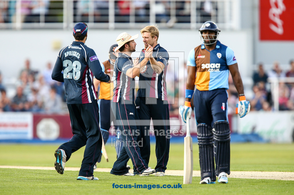 Chesney Hughes of Derbyshire Falcons  (right) leaves the field after being dismissed during the Natwest T20 Blast match at the County Ground, Northampton<br /> Picture by Andy Kearns/Focus Images Ltd 0781 864 4264<br /> 11/07/2014