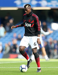 Manchester United's Paul Pogba warms up ahead of the match