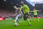 Ezgjan Alioski of Leeds United (10) and David McGoldrick of Sheffield United (17) in action during the EFL Sky Bet Championship match between Leeds United and Sheffield United at Elland Road, Leeds, England on 16 March 2019.