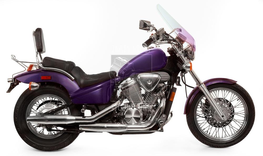 Purple Honda 600 VLX motorcycle shot on white background