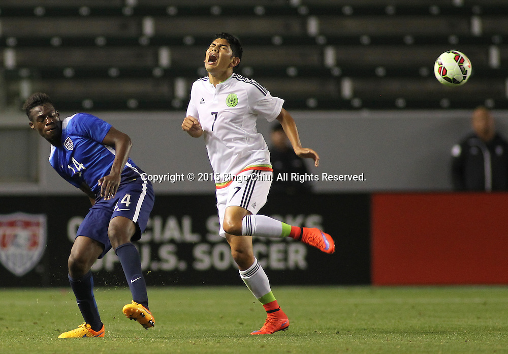 United States' Fatai Alashe #14 and Mexico's Jorge Espericueta #7 fight for a ball during a men's national team international friendly match, April 22, 2015, at StubHub Center in Carson, California. United States won 3-0. (Photo by Ringo Chiu/PHOTOFORMULA.com)