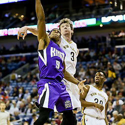 Jan 28, 2016; New Orleans, LA, USA; Sacramento Kings guard Rajon Rondo (9) shoots over New Orleans Pelicans center Omer Asik (3) during the first quarter of a game at the Smoothie King Center. Mandatory Credit: Derick E. Hingle-USA TODAY Sports