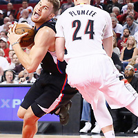 25 April 2016: Los Angeles Clippers forward Blake Griffin (32) drives past Portland Trail Blazers center Mason Plumlee (24) during the Portland Trail Blazers 98-84 victory over the Los Angeles Clippers, during Game Four of the Western Conference Quarterfinals of the NBA Playoffs at the Moda Center, Portland, Oregon, USA.