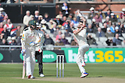 James Anderson in his delivery stride watched on by Stuart Broad during the Specsavers County Champ Div 1 match between Lancashire County Cricket Club and Nottinghamshire County Cricket Club at the Emirates, Old Trafford, Manchester, United Kingdom on 17 April 2016. Photo by Simon Trafford.