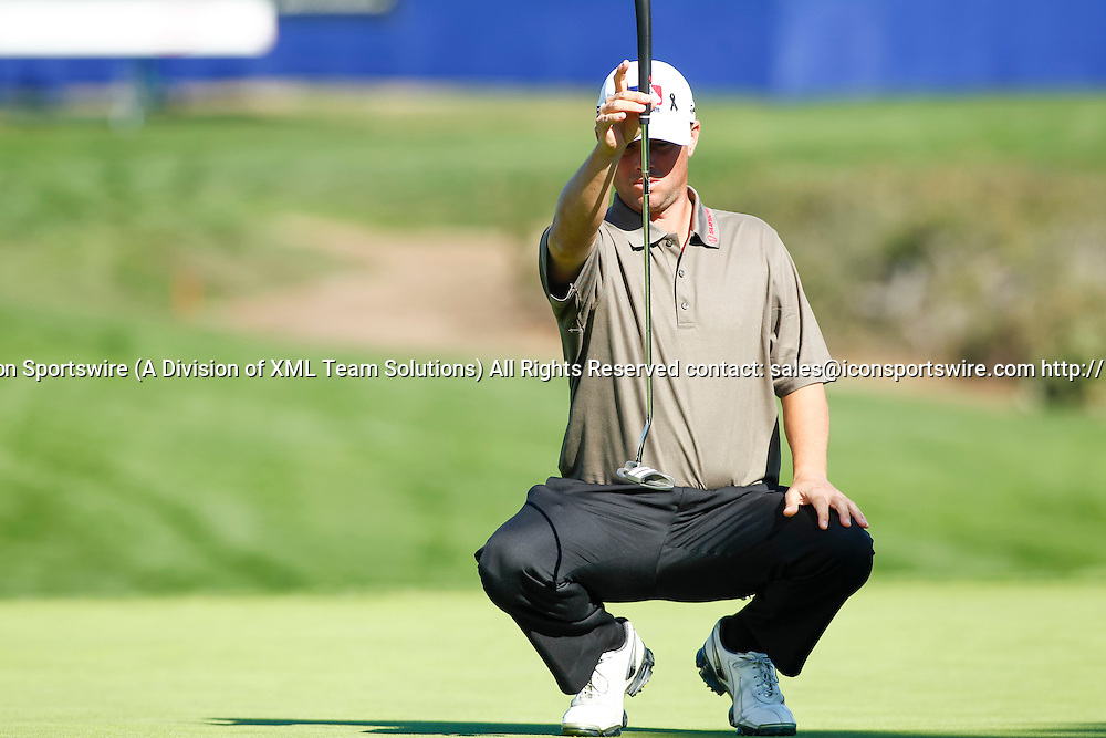 February 7, 2015:  Spencer Levin lines up his putt on the 16th green on the Torrey Pines Golf Course during the third round of the Farmers Insurance Open in San Diego, Ca.