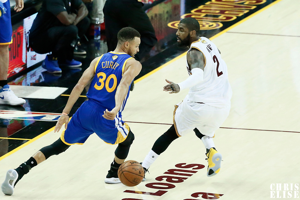 07 June 2017: Golden State Warriors guard Stephen Curry (30) drives past Cleveland Cavaliers guard Kyrie Irving (2) during the Golden State Warriors 118-113 victory over the Cleveland Cavaliers, in game 3 of the 2017 NBA Finals, at  the Quicken Loans Arena, Cleveland, Ohio, USA.