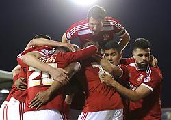 Swindon Town's Jonathan Obika celebrates with his team mates after scoring a goal - Photo mandatory by-line: Dougie Allward/JMP - Mobile: 07966 386802 - 11/05/2015 - SPORT - Football - Swindon - County Ground - Swindon Town v Sheffield United - Sky Bet League One - Play-Off