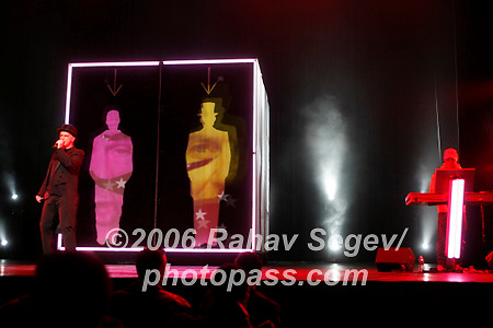 The Pet Shop Boys performing at Radio City Music Hall on October 14, 2006. .The band is; .Neil Tennant in top hat - vocals.Chris Lowe - yellow jacket and cap with glasses on keyboards.<br />