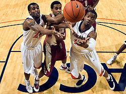 Virginia forward Jamil Tucker (12) and guard Jeff Jones (23) grab a rebound from Florida State guard Derwin Kitchen (22).  The Virginia Cavaliers fell to the Florida State Seminoles 73-62 in NCAA Basketball at the John Paul Jones Arena on the Grounds of the University of Virginia in Charlottesville, VA on January 24, 2009.