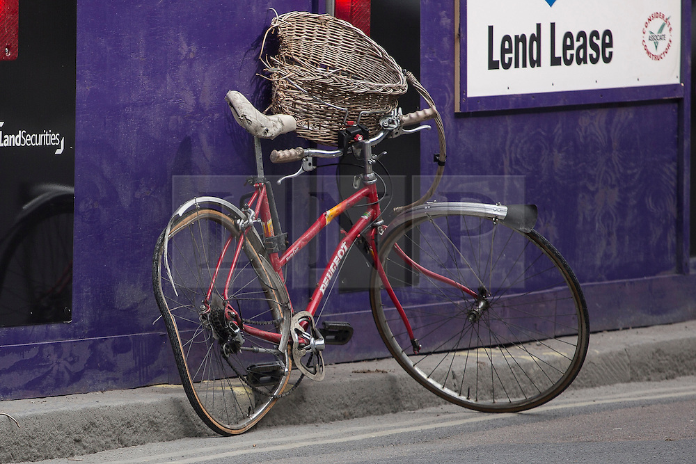 © licensed to London News Pictures. London, UK 08/04/2013. Bike of a woman cyclist who was killed in a rush hour collision on Victoria Street, London. Photo credit: Tolga Akmen/LNP