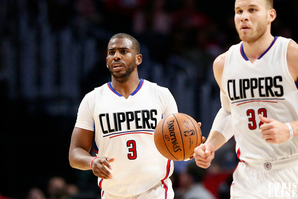 25 March 2016: LA Clippers guard Chris Paul (3) brings the ball up court next to LA Clippers forward Blake Griffin (32) during the Los Angeles Clippers 108-95 victory over the Utah Jazz, at the Staples Center, Los Angeles, California, USA.