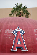 ANAHEIM, CA - JULY 20:  A palm tree appears above a metal baseball cap outside the stadium before the Los Angeles Angels of Anaheim game against the Seattle Mariners at Angel Stadium on Sunday, July 20, 2014 in Anaheim, California. The Angels won the game 6-5. (Photo by Paul Spinelli/MLB Photos via Getty Images)