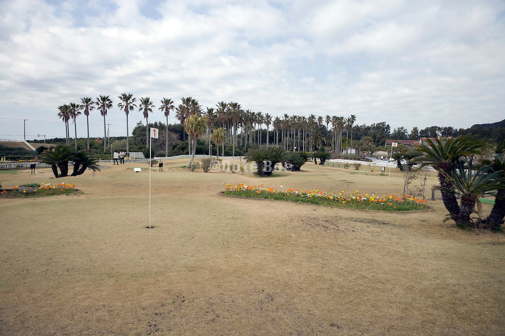 golf course with brown grass and hole number 1