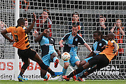 Wycombe defenders Aaron Pierre and Michael Harriman combine to keep out a joint effort from John Akinde and Bira Dembele during the Sky Bet League 2 match between Barnet and Wycombe Wanderers at The Hive Stadium, London, England on 15 August 2015. Photo by Bennett Dean.
