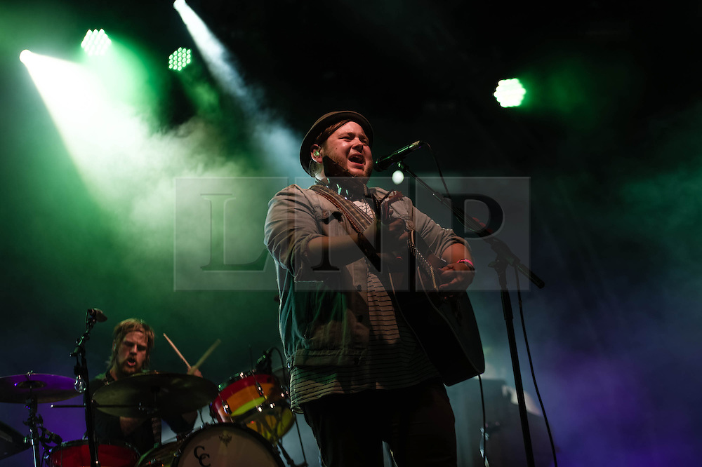 "© Licensed to London News Pictures. 16/07/2013. London, UK.   Of Monsters and Men performing live at Somerset House. In this pic - Arnar Rósenkranz Hilmarsson (left) and Ragnar ""Raggi"" Þórhallsson (right). Of Monsters and Men is a six-piece, English-language, indie folk/pop band from Iceland consisting of lead singer/guitarist Nanna Bryndís Hilmarsdóttir, co-singer/guitarist Ragnar ""Raggi"" Þórhallsson, guitarist Brynjar Leifsson, drummer Arnar Rósenkranz Hilmarsson and bassist Kristján Páll Kristjánsson.  Photo credit : Richard Isaac/LNP"