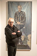 UNITED KINGDOM, London: 08 May 2019 <br /> Drummer of punk band The Damned 'Rat Scabies' (real name Christopher John Miller) stands next to his portrait painted by Jason Bowyer at the launch of The Royal Society of Portrait Painters' annual exhibition at The Mall Galleries, London. <br /> The exhibition consists of faces both famous and not-so famous and is a celebration of the very best in contemporary portraiture nationally and internationally.<br /> Rick Findler