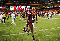 Sep 3, 2017; Landover, MD, USA; Virginia Tech Hokies quarterback Josh Jackson (17) celebrates after beating the West Virginia Mountaineers at FedEx Field. Mandatory Credit: Ben Queen-USA TODAY Sports