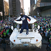 Seattle Seahawks player Marshawn Lynch throws Skittles back to the 12th Man during the Super Bowl Championship Parade on Wednesday, February 5, 2014 in downtown Seattle. An estimated 700,000 people came out to celebrate with Seattle's championship team. Throughout the season fans would throw the candies to Lynch on the field after he scored a touchdown. During the parade he returned the favor.