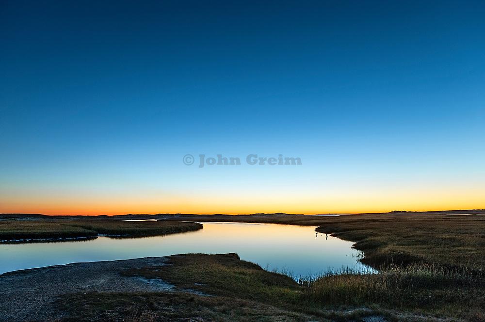 Sunrise over wetland salt pond, Sandwich, Cape Cod, Massachusetts, USA.