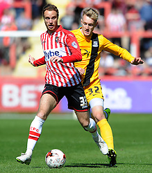 Exeter City's Ryan Harley is tackled by Southend United's Joe Pigott- Photo mandatory by-line: Harry Trump/JMP - Mobile: 07966 386802 - 18/04/15 - SPORT - FOOTBALL - Sky Bet League Two - Exeter City v Southend United - St James Park, Exeter, England.