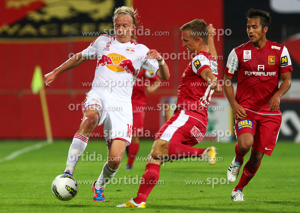 18.08.2012, Trenkwalder Arena, Maria Enzersdorf, AUT, 1. FBL, FC Admira Wacker Moedling vs FC Red Bull Salzburg, im Bild Havard Nielsen, (Red Bull Salzburg, #16), Andreas Schrott, (FC Admira Wacker Moedling, #14) und Stephan Palla, (FC Admira Wacker Moedling, #3)  // during Austrian Bundesliga Football Match, round 1, between FC Admira Wacker Moedling vs FC Red Bull Salzburg at the Trenkwalder Arena, Maria Enzersdorf, Austria on 2012/08/18. EXPA Pictures © 2012, PhotoCredit: EXPA/ Thomas Haumer